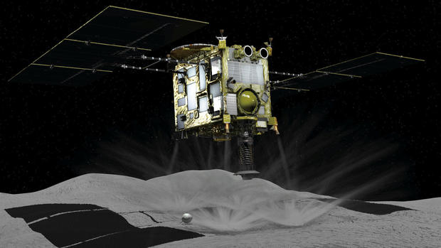 A computer graphic handout image shows Japan Aerospace Exploration Agency's Hayabusa 2 probe touches down on an asteroid in outer space