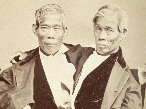 V0029573 Chang and Eng, conjoined twins, seated. P
