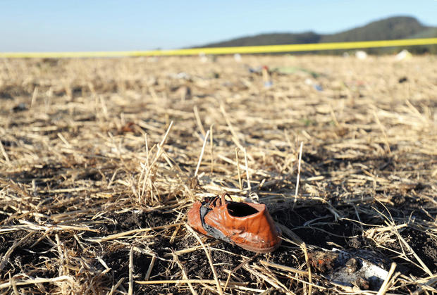 A shoe of a passenger is seen at the scene of the Ethiopian Airlines Flight ET 302 plane crash, near the town of Bishoftu, southeast of Addis Ababa