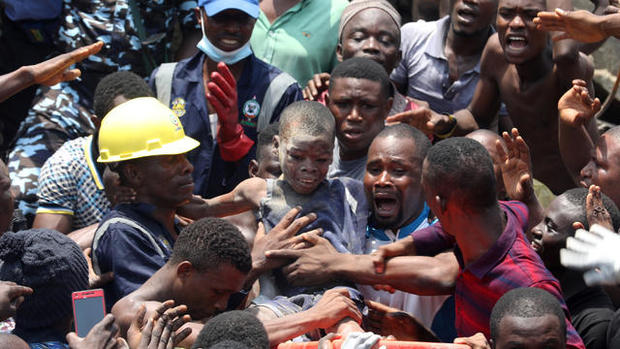 cbsn-fusion-desperate-rescue-efforts-underway-for-children-trapped-beneath-collapsed-school-building-in-nigeria-thumbnail-1803058-640x360.jpg