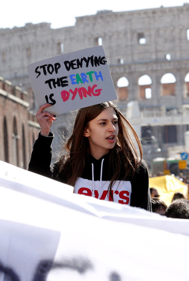 Italian students gather near the Colosseum to call for action on climate change, in Rome