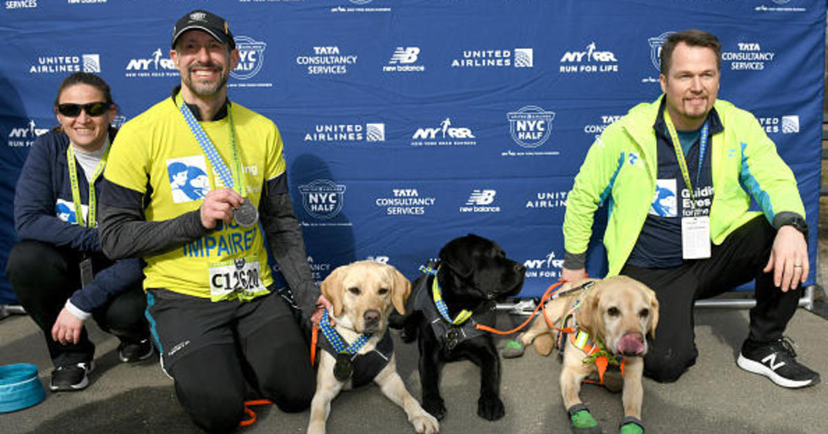 Blind runner makes history by finishing NYC Half Marathon with help of guide dogs