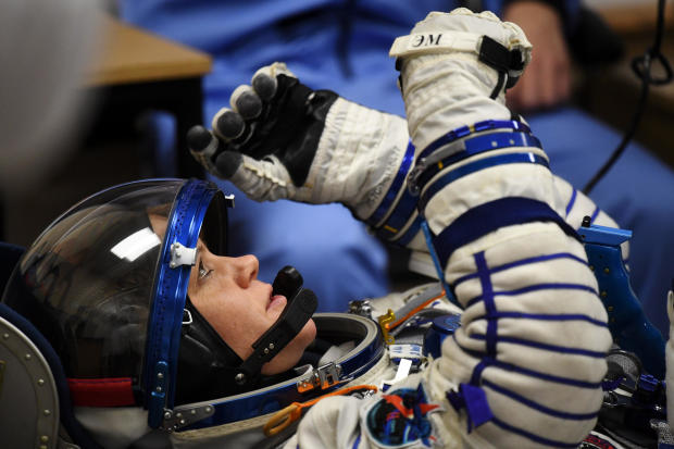 NASA astronaut Anne McClain, a member of International Space Station expedition 58/59, reacts as her spacesuit is tested prior to launch onboard the Soyuz MS-11 spacecraft at the Russian-leased Baikonur cosmodrome in Kazakhstan on Dec. 3, 2018.