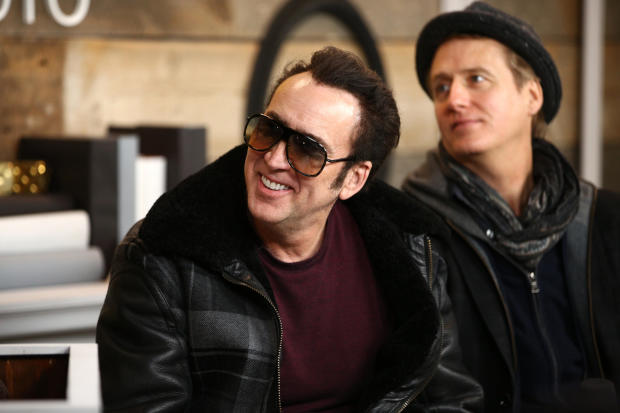 """Actors Nicolas Cage, center, and Linus Roache of """"Mandy"""" look on at the IMDb Studio at the Sundance Film Festival on Jan. 19, 2018, in Park City, Utah."""