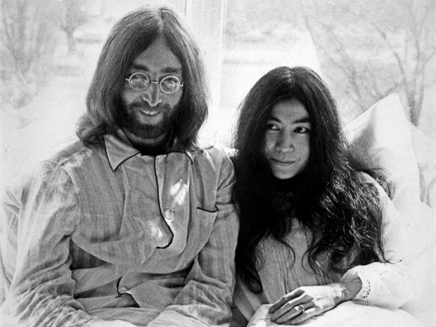 Beatles member John Lennon and his wife Yoko Ono receive journalists March 25, 1969, in the bedroom of their Hilton hotel suite in Amsterdam during their honeymoon in Europe.