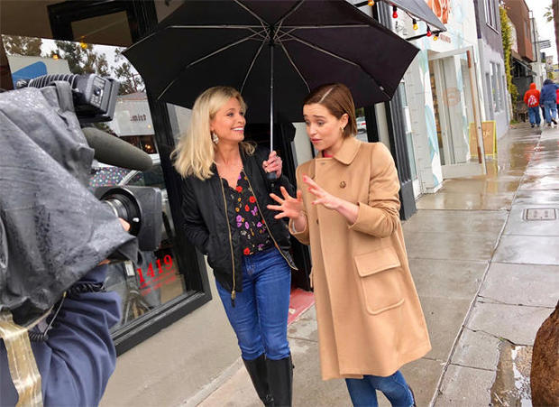 emilia-clarke-and-tracy-smith-in-the-rain-cbs-news.jpg