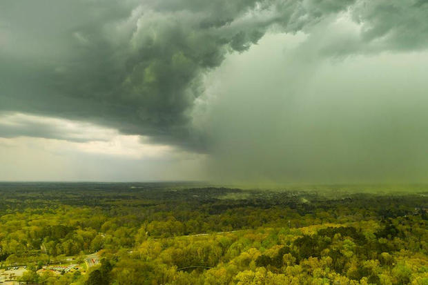 An aerial view shows storm clouds pushing pollen over an area in Durham, North Carolina