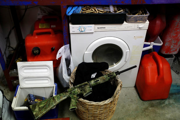 Noel Womersley's AR-15 semi-automatic rifle is seen in the garage of his house outside Christchurch