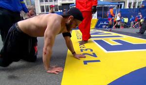 Veteran crawls across Boston Marathon finish line in honor of fallen Marines