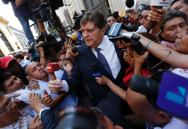 Former Peruvian President Alan Garcia talks to the media after testifying on the Brazilian construction giant Odebrecht bribes case in Lima on Feb. 16, 2017.
