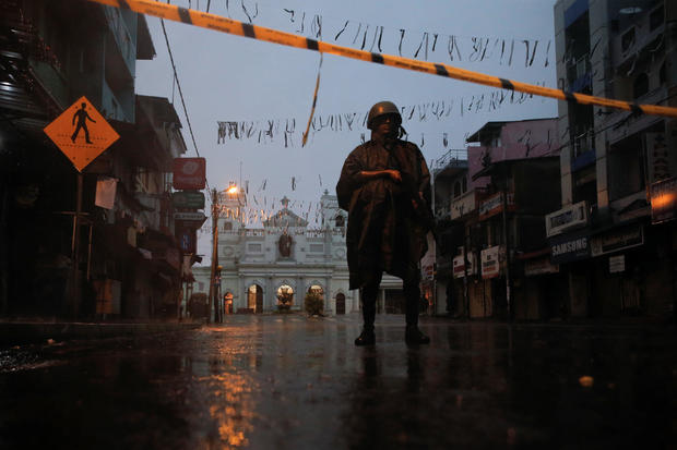 A soldier stands guard at St. Anthony's Shrine, days after a string of suicide bomb attacks on churches and luxury hotels across the island on Easter Sunday, in Colombo