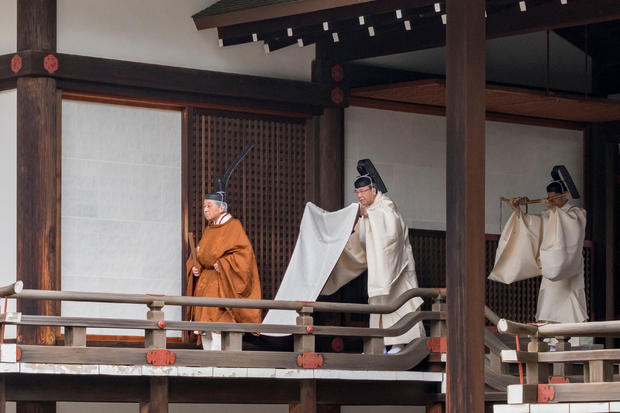 Japan's Emperor Akihito walks for a ritual called Taiirei-Tojitsu-Kashikodokoro-Omae-no-gi, a ceremony for the Emperor to report the conduct of the abdication ceremony, at the Imperial Palace in Tokyo