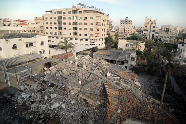 View shows the remains of a building that was destroyed in Israeli air strikes, in Gaza City