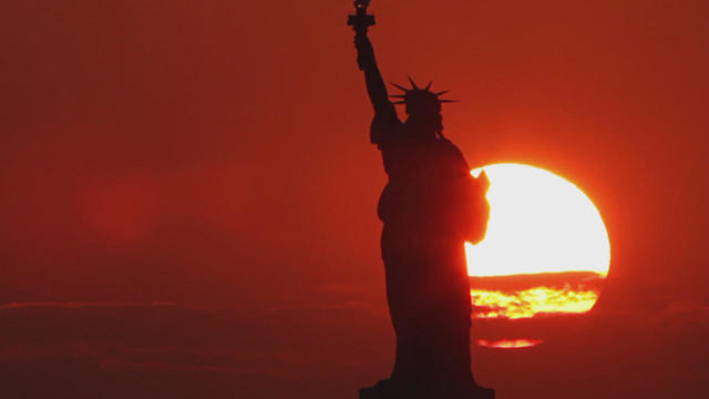 statue-of-liberty-sunset-silhouette-promo.jpg