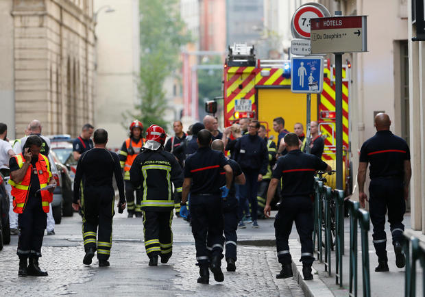 Fire fighters and medics are seen near the site of a suspected bomb attack in central Lyon