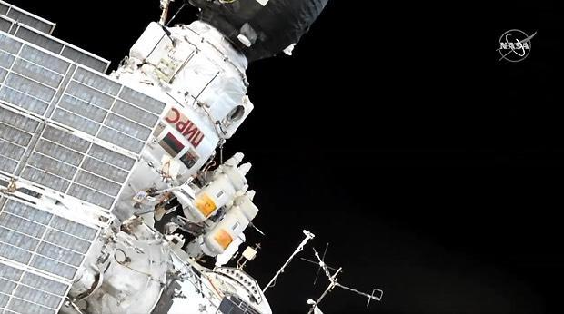Russians venture into open space from Space Station