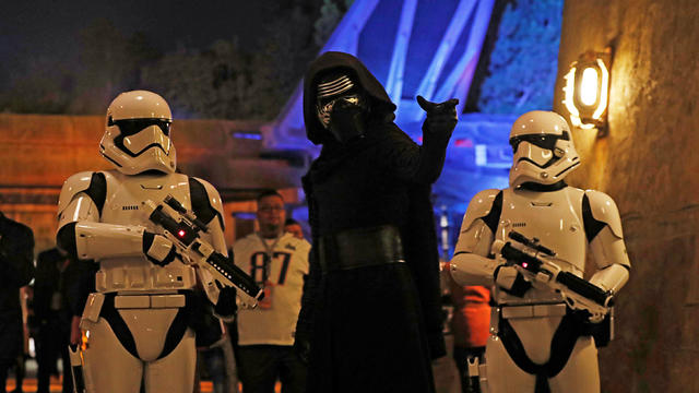 "People dressed as stormtroopers and the character Kylo Ren react at ""Star Wars: Galaxy's Edge"" at Disneyland Park in Anaheim"