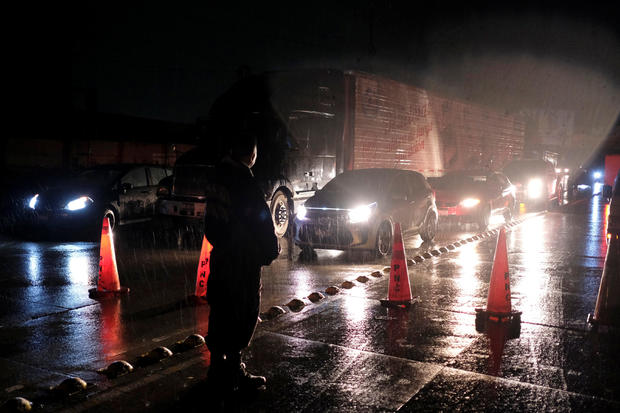 Policemen make traffic stop following an earthquake on a highway in San Salvador