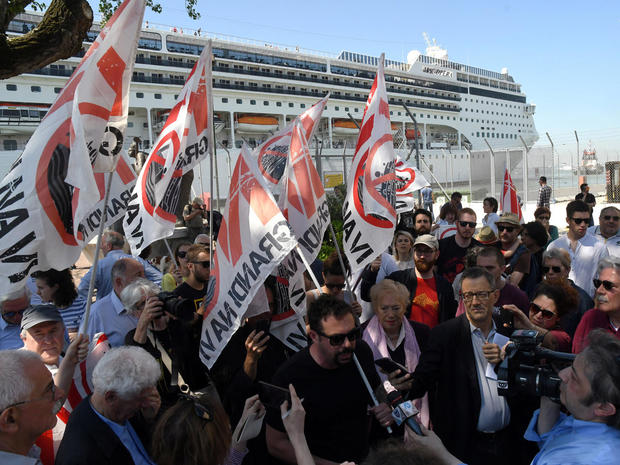 "Members of ""No grandi navi - No big ships"" movement protest in front of the MSC Opera cruise ship that early in the morning crashed against a smaller tourist boat at the San Basilio dock in Venice"