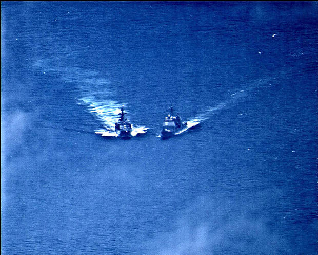 A surveillance photo shows the Russian naval destroyer Udaloy making a maneuver against the USS Chancellorsville