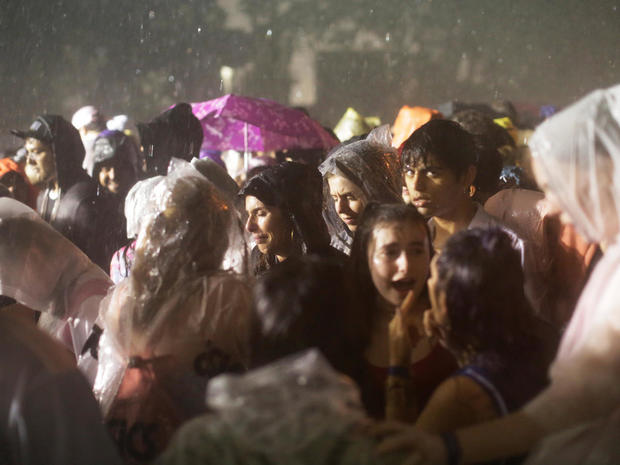 Attendees evacuate the festival grounds due to severe weather during the Governors Ball Music Festival at Randall's Island Park in New York