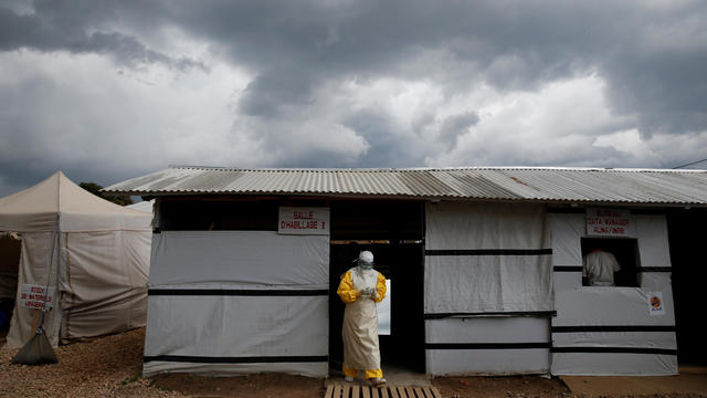 FILE PHOTO: A health worker wearing Ebola protection gear, leaves the dressing room before entering the Biosecure Emergency Care Unit at the ALIMA Ebola treatment centre in Beni