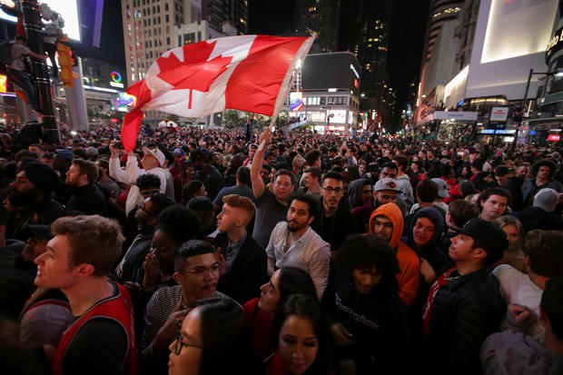 Fans celebrate in the streets of Toronto, Canada after the Toronto Raptors win the NBA Championship in Toronto