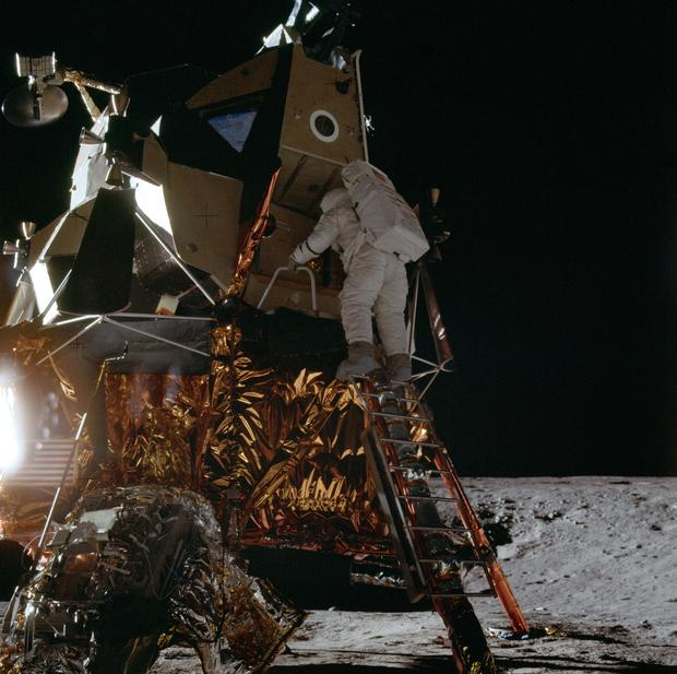 Apollo 12 Mission image - Dark view of Astronaut Alan L. Bean climbing down the ladder of the Lunar Module (LM)