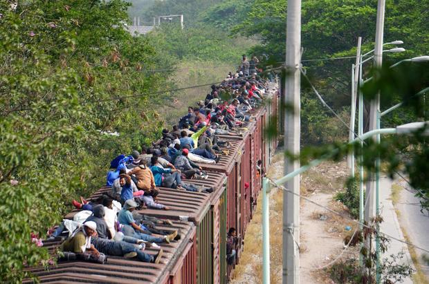 FILE PHOTO: Central American migrants ride train through Juchitan, Oaxaca