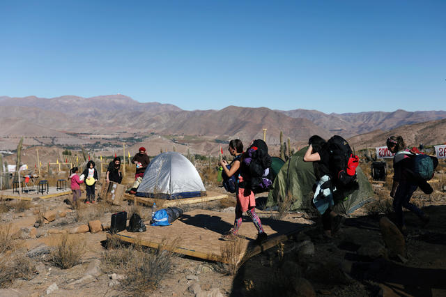 Tourists arrive at a campsite before a total solar eclipse to take place on July 2, at the Mamalluca Observatory, in Valle del Elqui