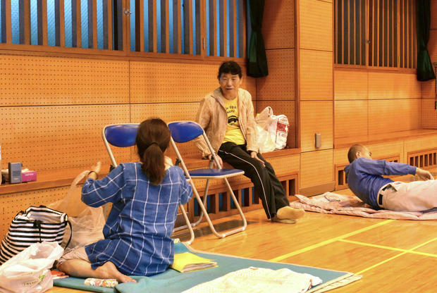 Local residenst take a rest at a shelter in evacuation centre as heavy rains threatened to trigger landslides and cause other damage, in Kagoshima, Japan