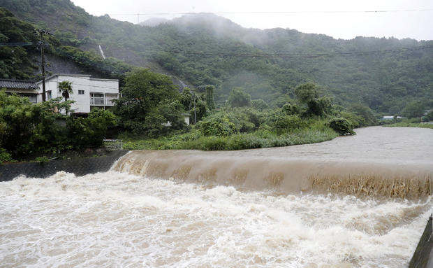 The Futami River is swollen due to heavy rain in Yatsushiro, Kumamoto Prefecture, southwestern Japan