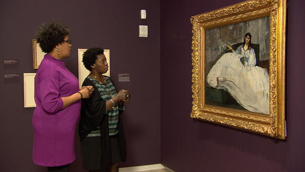 correspondent-nancy-giles-and-curator-denise-murrell-with-manet-painting-jeanne-duval-baudelaires-mistress.jpg
