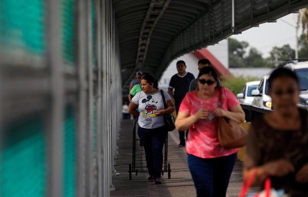 People cross the the Brownsville-Matamoros International Bridge on the U.S.-Mexico border in Matamoros, Tamaulipas