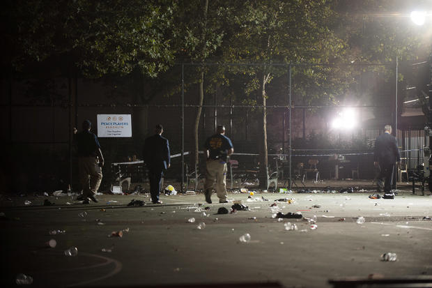 Members of the NYPD investigate a shooting at the Brownsville Recreational Center in New York City