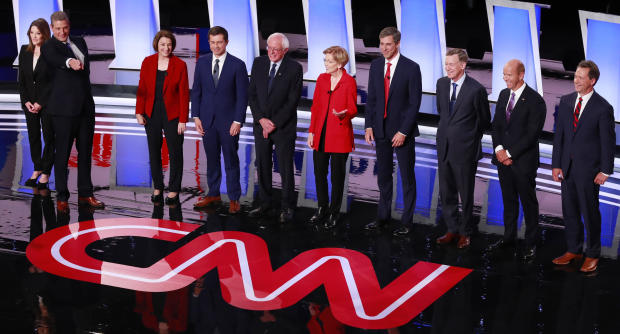 Candidates shake pose before the start of the first night of the second 2020 Democratic U.S. presidential debate in Detroit, Michigan, U.S.