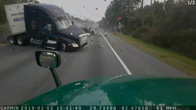 Jarring new video shows the moment a semi-truck plowed into van, killing 7