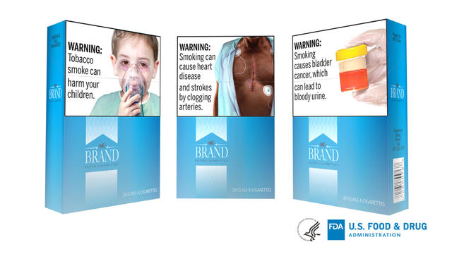 Handout photo of an rtist's rendition of the U.S. Food and Drug Administration's (FDA) proposed cigarette packaging carrying graphic new health warnings