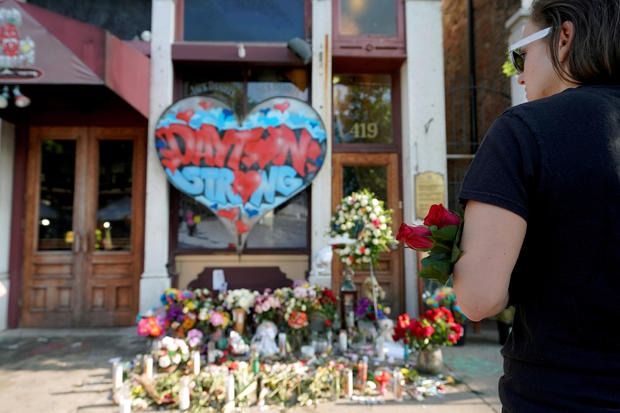 FILE PHOTO: A Oregon District resident stands at a memorial for those killed during Sunday morning's a mass shooting in Dayton