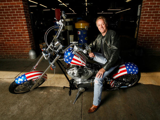 "FILE PHOTO: Fonda poses for a portrait on a replica of the ""Captain America"" bike in Glendale"