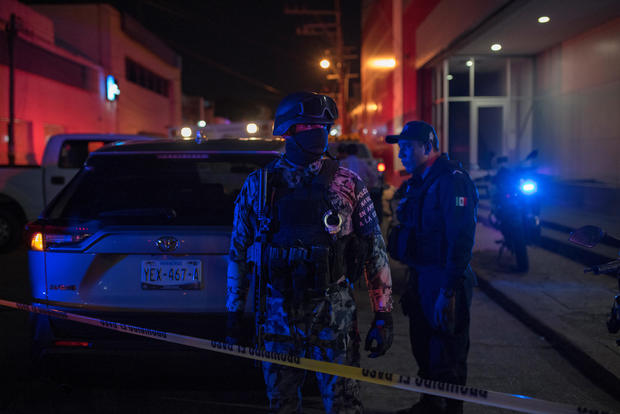Federal forces keep watch at a crime scene following a deadly attack at a bar by unknown assailants in Coatzacoalcos
