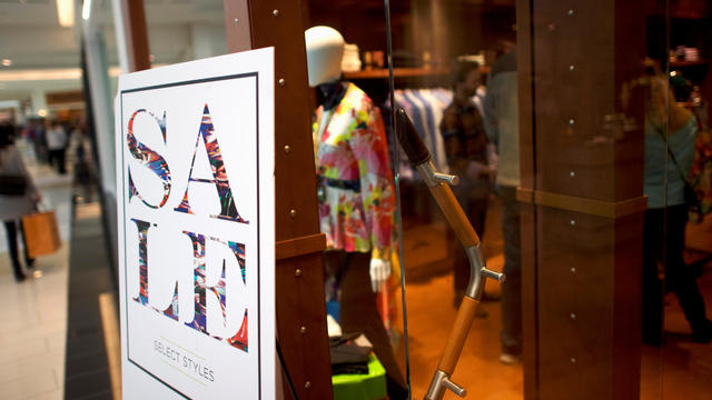A sale sign is positioned outside the Robert Graham store of the King of Prussia Mall, United States' largest retail shopping space, in King of Prussia