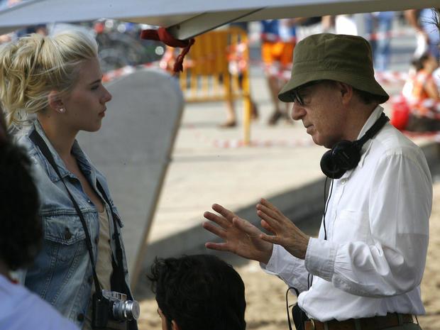US director Woody Allen (R) speaks to US