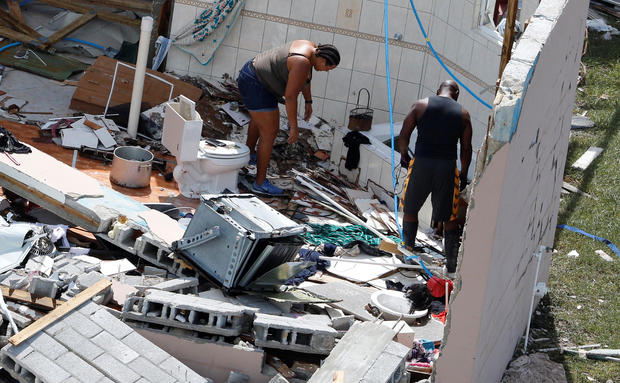Residents look through debris after hurricane Dorian hit the Grand Bahama Island in the Bahamas