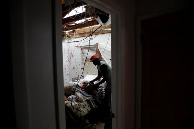 A man packs his clothes at this home after hurricane Dorian hit the Abaco Islands in Marsh Harbour
