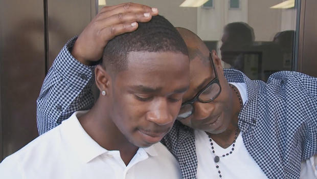 exonerated-royal-clark-jr-with-his-son.jpg
