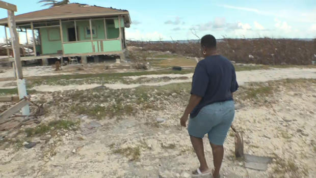 bahamas-eva-thomas-outside-her-home-with-shovel-620.jpg