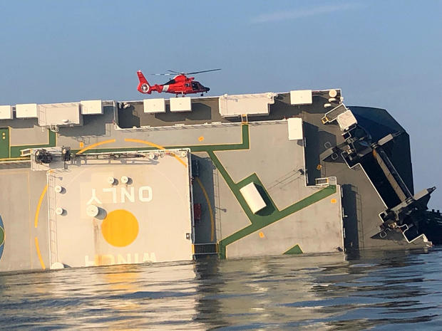 ​A U.S. Coast Guard helicopter hovers over an overturned cargo ship in Georgia's St. Simons Sound September 9, 2019, in an image released by the Coast Guard.