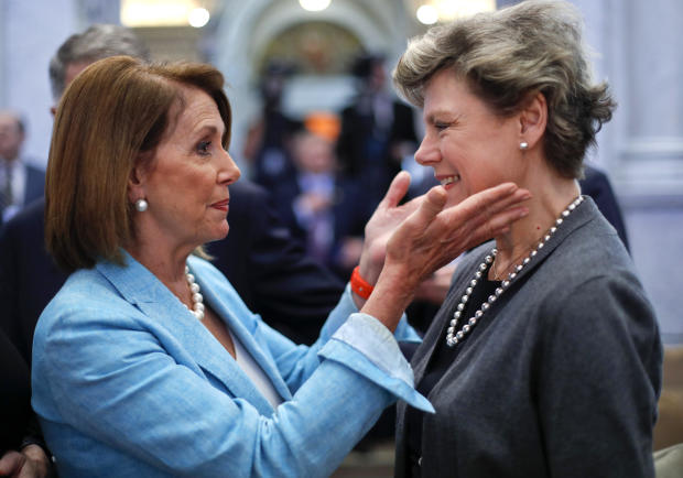 Then-House Democratic Leader Nancy Pelosi, left, greets journalist Cokie Roberts in the Great Hall of the Library of Congress in Washington, September 14, 2016. Both women attended the oath of office ceremony for the new librarian of Congress, Carla Hayden.