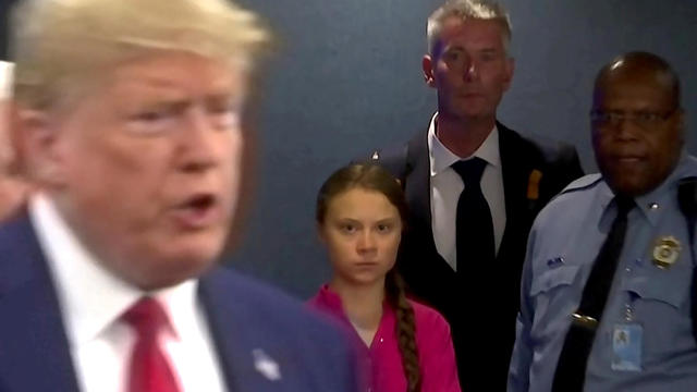 Swedish environmental activist Greta Thunberg watches as U.S. President Donald Trump enters the United Nations